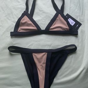Brand new bathing suit, never worn.